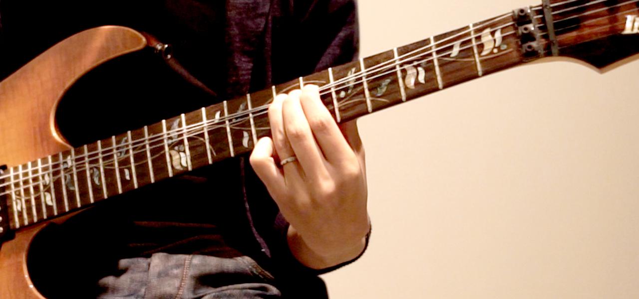 5〜6弦は下に引っ張る